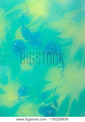 Abstract Textured Yellow- Turquoise Background with Blue Splashes Made with Paint Shampoo Glass and Paper