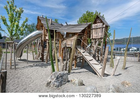 Adventure playground made of wood at a lake. Taken in Bodman at Lake Constance, Germany.