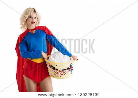 Attractive superwoman with basket of dirty clothes