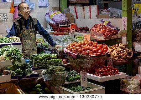 Hong Kong, China - 19 April 2016: asian man selling vegitables on traditional market