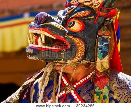 Unidentified monk performs a religious mask dance during the Cham Dance Festival in Kursha monastery, Zanskar, northern India.