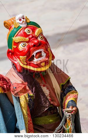 Unidentified monk performs a religious masked and costumed mystery dance of Tibetan Buddhism during the Cham Dance Festival in Hemis monastery India.