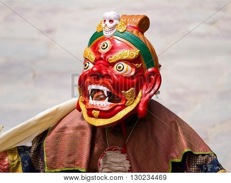 Unidentified monk performs a religious masked and costumed mystery dance of Tibetan Buddhism during the Cham Dance Festival on June 29 2012 in Hemis monastery India.