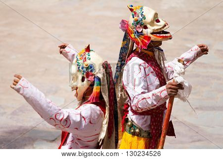 Unidentified monks performs a religious masked and costumed mystery dance of Tibetan Buddhism during the Cham Dance Festival in Hemis monastery India.