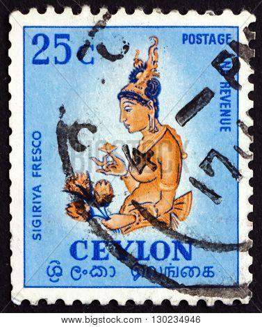 SRI LANKA - CIRCA 1954: a stamp printed in Sri Lanka shows Women Holding Flower Sigiriya 5th Century Temple Painting circa 1954