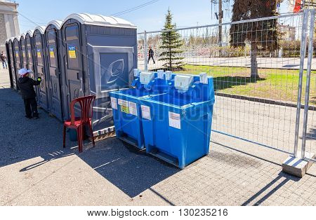 SAMARA RUSSIA - APRIL 24 2016: Mobile public toilets and equipment for washing hands at the central square in summer day