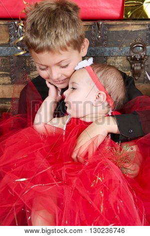 Young boy with his baby sister at christmas time