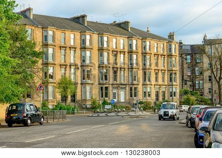 GLASGOW SCOTLAND - MAY 16 2016: A fine tenement appartment building in Queen Margaret Drive in the west end of Glasgow.