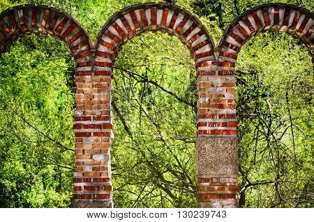 Photo of Brick Arch in Green Wild Nature