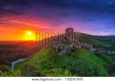 Ruins of the Corfe castle at beautiful sunrisein County Dorset, UK