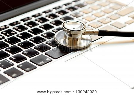 doctor workplace with a stethoscope and laptop  close up