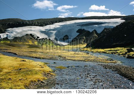 Landscape with moss, river and snow in Iceland. Mountain tourism