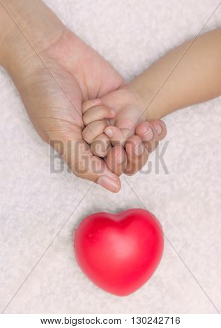 New Born Baby Hand In Mom Palm With Red Heart