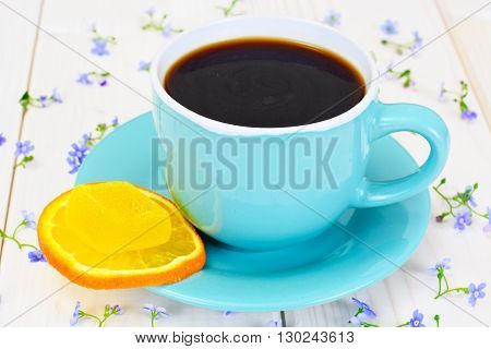 Coffee  in a blue retro cup with Flowers. Studio Photo