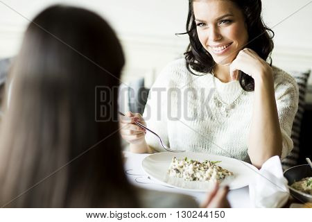 Women At The Table In The Restaurant