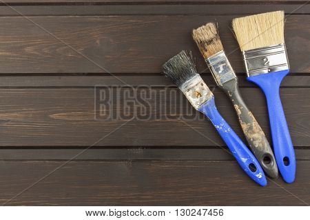 Paint brush on wooden background. Sales of paints and brushes. Housework. Supplies for painters.
