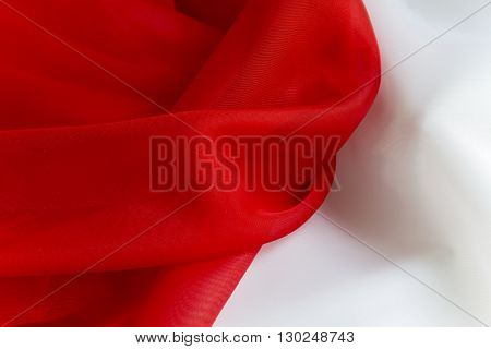 delicate Red on White silky fabric folds background texture
