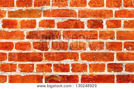 Old weathered grunge red brick wall as background