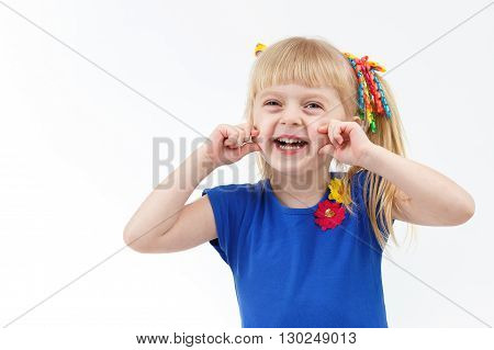 Funny Little Blond Girl With Two Tails Making Grimace And Smiling