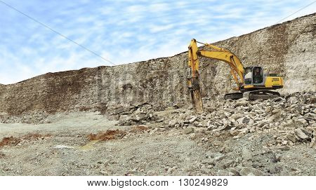Yellow hammer on the quarry for limestone mining