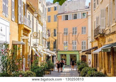 AIX-EN-PROVENCE FRANCE - JUL 17 2014: Beautiful shopping area in Aix-En-Provence with tourists walking betweens luxury shops on a warm summer day on Rue Nazareth