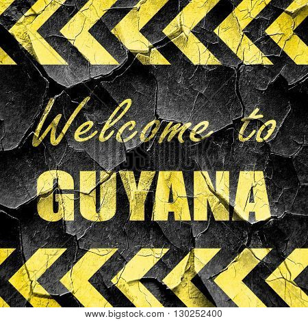 Welcome to guyana, black and yellow rough hazard stripes