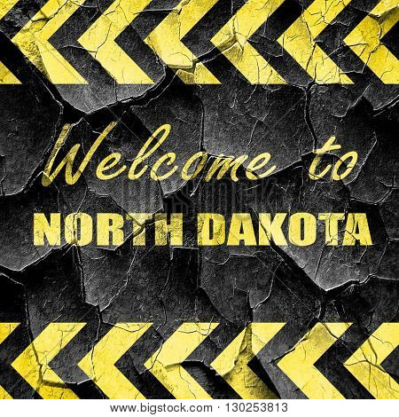 Welcome to north dakota, black and yellow rough hazard stripes