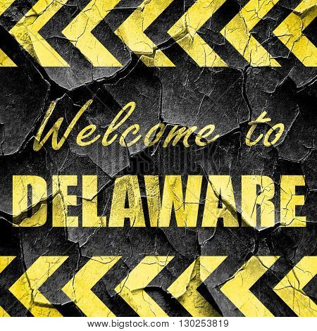 Welcome to delaware, black and yellow rough hazard stripes