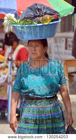 QUETZALTENANGO GUATEMALA april 28 2016 : Woman carring fruits in Quetzaltenango maket. This native market is the most colorful in Central America