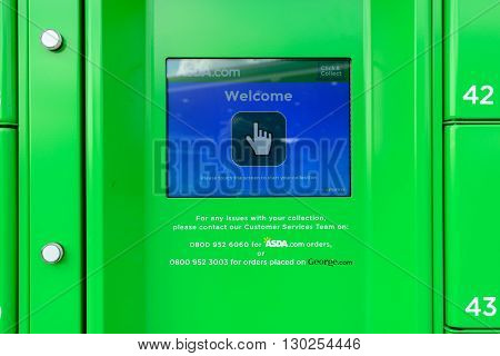 EDINBURGH, SCOTLAND - MAY 15, 2016: Customer terminal at Asda Collection Point at a fuel station in Newbridge near Edinburgh. Customers can order online and collect groceries at Click and Collect Lockers.