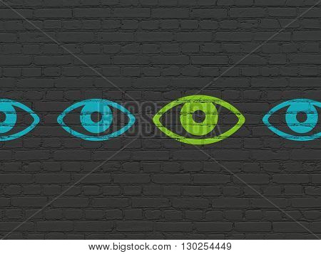 Privacy concept: row of Painted blue eye icons around green eye icon on Black Brick wall background
