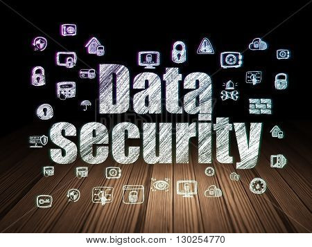 Protection concept: Glowing text Data Security,  Hand Drawn Security Icons in grunge dark room with Wooden Floor, black background