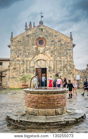 LUCCA ITALY - JUNE 14 2014. Church and people in a sunny day medieval fortress of San Gimignano Tuscany