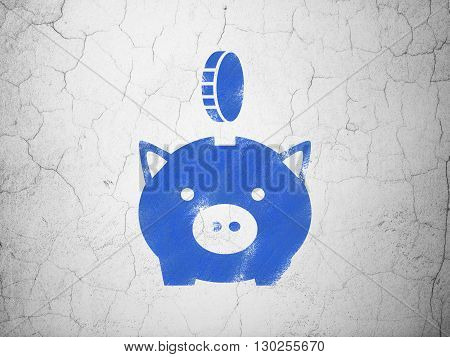 Banking concept: Blue Money Box With Coin on textured concrete wall background