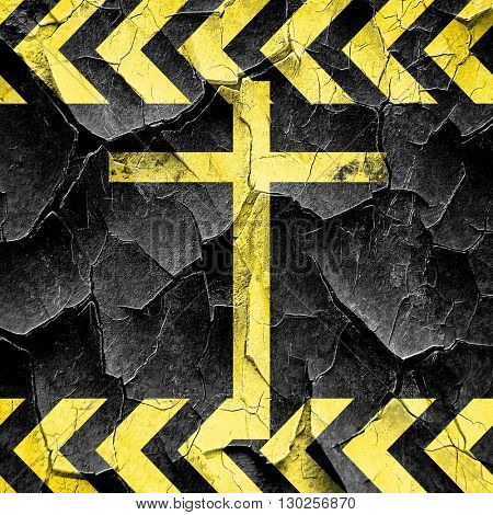 Christian cross icon, black and yellow rough hazard stripes