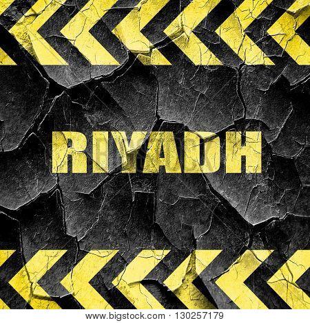 riyadh, black and yellow rough hazard stripes