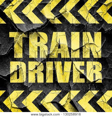 train driver, black and yellow rough hazard stripes