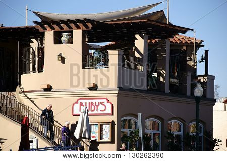 SAN JUAN CAPISTRANO, UNITED STATES - DECEMBER 25: The Vintage facade in Adobe style of Ruby's diner with visitors on December 25, 2015 in San Juan Capistrano.