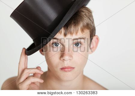 Serious Child Tipping His Hat On Head