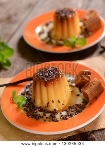Panna cotta with caramel suce and chocolate flakes