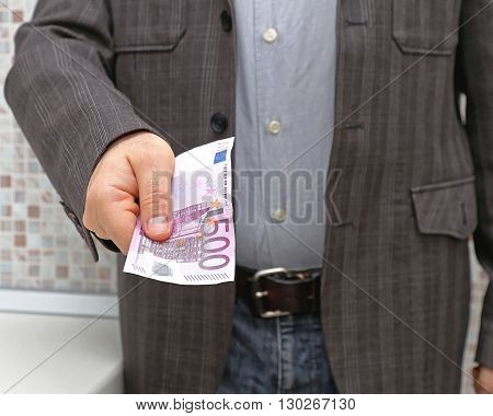 Man in Suit Giving Euro Money Bribery Offer