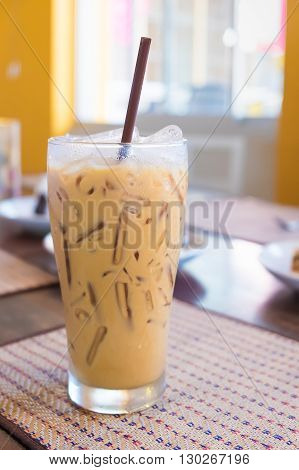 Iced Coffee With Milk Is On The Mat