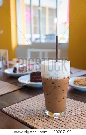 Iced Mocha Coffee With Milk Is On The Mat