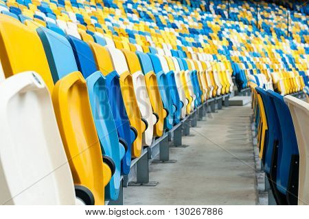 Empty plastic seats in a footbal or soccer stadium. 2016 sport background.