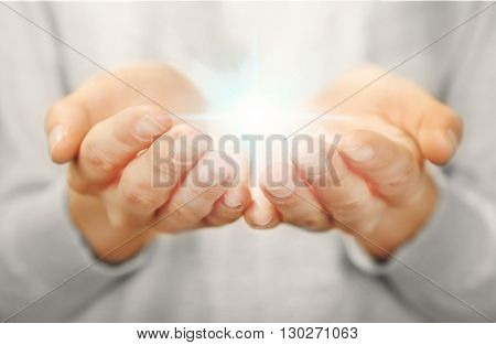 Light in hands.  Concept of taking, care, protection