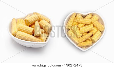 mini fresh corn   in a heart shaped bowl, isolated on white