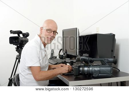 a mature video editor in his studio