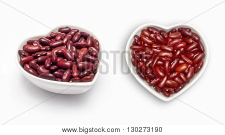 red beans  in a heart shaped bowl, isolated on white