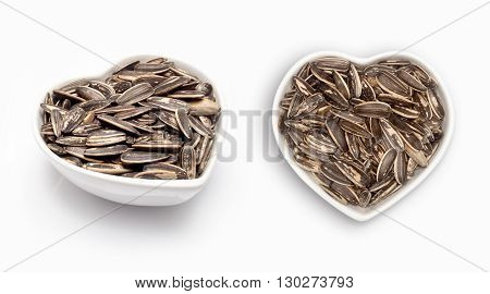 Sunflower in a heart shaped bowl, isolated on white