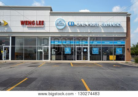 JOLIET, ILLINOIS / UNITED STATES - AUGUST 16, 2015: One may eat Chinese food at Weng Lee Chinese Kitchen, and have one's clothes cleaned at CD One Price Cleaners, in a Joliet strip mall.